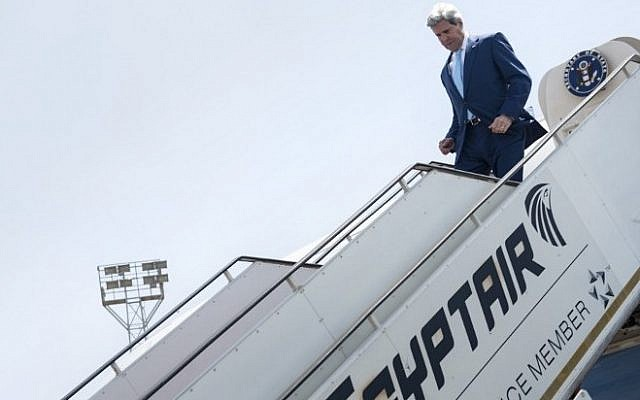 US Secretary of State John Kerry disembarks upon his arrival at Cairo International Airport, June 22, 2014, in the Egyptian capital. (photo credit: AFP/Pool/Brendan Smialowski/file)