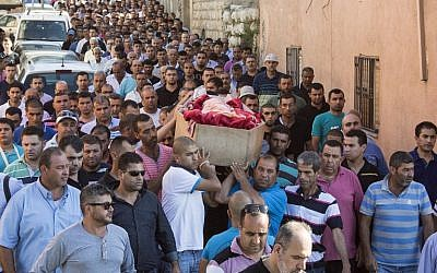 Relatives of Arab Israeli youth Mohammed Karkara,15, carry his coffin during his funeral in the northern Israeli village of Arrabe on June 23, 2014. (AFP/JACK GUEZ)