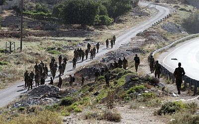Illustrative: Israeli soldiers begin a search operation in the village of Halhul, near the West Bank town of Hebron, on June 29, 2014. (photo credit: AFP/HAZEM BADER)