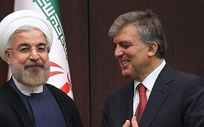 Turkish President Abdullah Gul (R) and Iranian President Hassan Rouhani speak during a press conference at the presidential palace in Ankara, on June 9, 2014. (photo credit: AFP PHOTO/ADEM ALTAN)