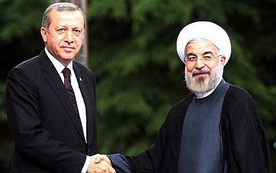 Then-Turkish Prime Minister Recep Tayyip Erdoğan welcomes Iranian President Hassan Rohani to his office in Ankara in 2014 (Photo: AFP)