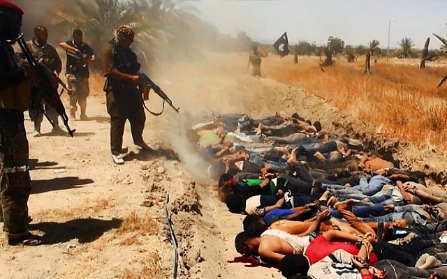 An image uploaded on June 14, 2014 on the jihadist website Welayat Salahuddin allegedly shows militants of the Islamic State of Iraq and the Levant (ISIL) executing dozens of captured Iraqi security forces members at an unknown location in the Salaheddin province. (photo credit: AFP/HO/Welayat Salahuddin)