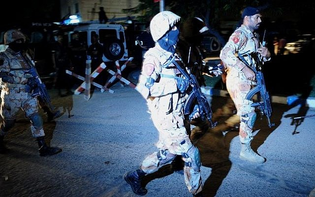 Pakistani security personnel arrive at the militants assault site of the Jinnah International Airport in Karachi on late June 8, 2014. (Photo credit: AFP/Asif HASSAN)