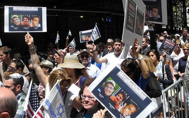 Protesters rally in support of three kidnapped Israeli teenagers during a demonstration in front of the Israeli consulate in New York on June 16, 2014. (photo credit: AFP/ Brigitte Dusseau)