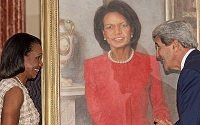US Secretary of State John Kerry (right) with former US secretary of state Condoleezza Rice during a ceremony to unveil the official painting of her that will hang in the State Department, June 2014. (photo credit: AFP/Paul J. Richards)