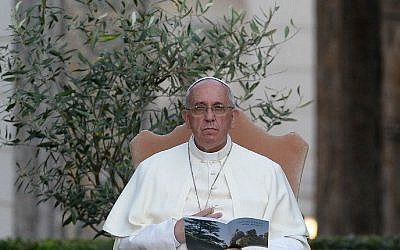 Pope Francis sits next to an olive tree during a joint peace prayer, June 8, 2014.  (photo credit: AFP/FILIPPO MONTEFORTE)