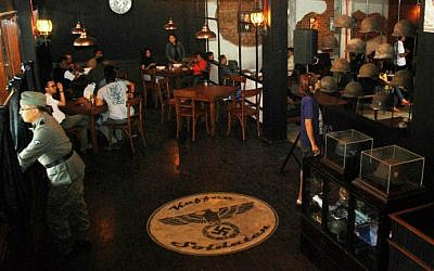 A Nazi swastika insignia sign on the floor decorates the interior of the reopened SoldatenKaffee in Bandung city, western Java island on June 21, 2014. (photo credit: AFP/TIMUR MATAHARI)