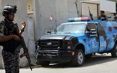 Iraqi policemen man a checkpoint in the capital Baghdad on June 12, 2014, as jihadists and anti-government fighters have spearheaded a major offensive that overrun all of Nineveh province. (photo credit: AFP/ Ahmad Al-Rubaye)