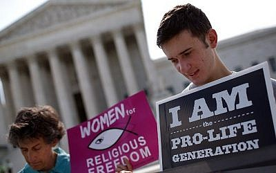 Illustrative: Pro-life activists gather outside the US Supreme Court in Washington, DC, on June 26, 2014. (photo credit: Win McNamee/Getty Images/AFP)