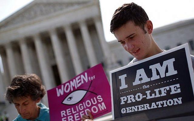 Pro-life activists gather outside the US Supreme Court in Washington, DC, on June 26, 2014. (photo credit: Win McNamee/Getty Images/AFP)