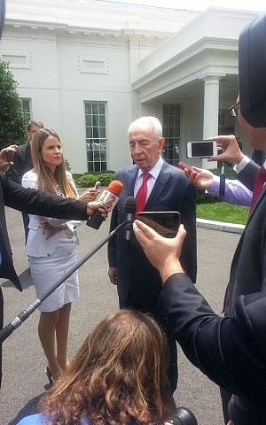 President Shimon Peres speaks to reporters after a June 25, 2014 meeting with US President Barack Obama at the White House. (Photo credit: Rebecca Shimoni Stoil)