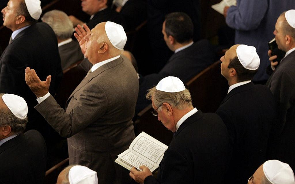 Members of Turkey's Jewish community pray at Neve Shalom Synagogue in Istanbul on October 11, 2004, during a ceremony to mark the official reopening of the synagogue (AP/Murad Sezer)