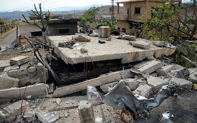 In this photo released by the Syrian official news agency SANA, damaged buildings wrecked by an Israeli airstrike are seen in Damascus, Syria, May 5, 2013 (photo credit: AP/SANA)