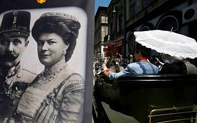 """Tourists pose for photos inside a replica of the """"Graf & Stift"""" car, parked in front of a museum at the historical street corner in downtown Sarajevo, where Gavrilo Princip assassinated Austro-Hungarian heir to the throne Archduke Franz Ferdinand, in Sarajevo, on Saturday, June 28, 2014. (AP Photo/Amel Emric)"""