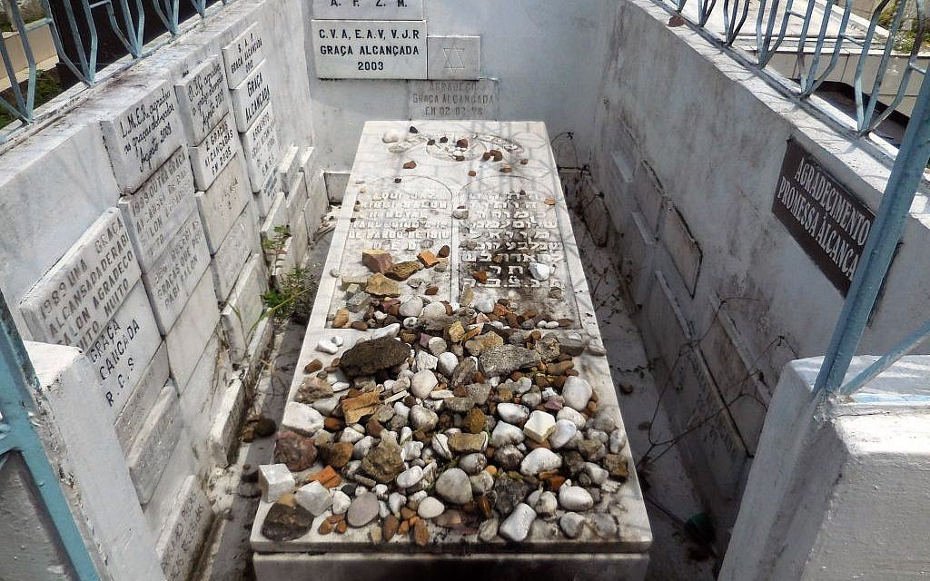 The tomb of Rabbi Shalom Imanuel Muyal, who died of yellow fever in 1910, lays at Saint John the Baptist Cemetery in Manaus, Friday, June 20, 2014. (photo credit:AP/Chris Lehourites)