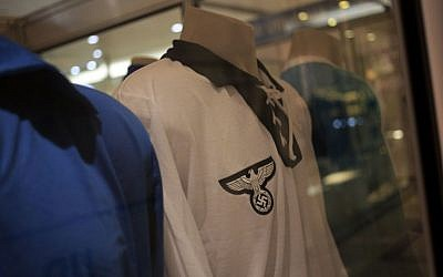 A Germany 1934 FIFA Soccer World Cup team jersey is displayed among other national soccer team jerseys on a shopping mall in Salvador, Brazil, Thursday, June 19, 2014. The Nazi eagle and swastika are clearly visible on the jersey's front. (photo credit: AP/Bernat Armangue)