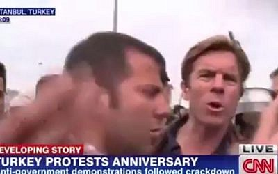 CNN International reporter Ivan Watson being detained by Turkish police live on-air, in Taksim Square, Istanbul, on May 31, 2014. (photo credit: screen capture YouTube)