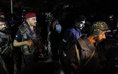 Pakistani commandos get ready to enter Karachi airport terminal following attacks by unknown gunmen on Sunday night, June 8, 2014, in Pakistan. (Photo credit: AP/Shakil Adil)