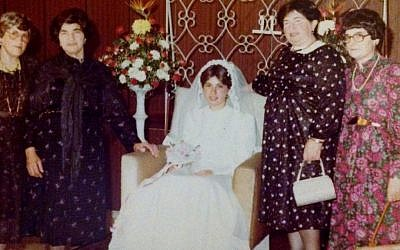 At a family wedding in Israel, Regina Ament, right, is shown with her sisters, from left, Feige, Baila and Hinda. (Courtesy Chanoch Korman/via JTA)