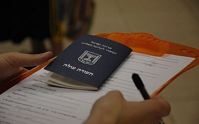 A new Israeli immigrant receiving an identification card,  Jerusalem, May 3, 2010. (photo credit: Rachael Cerrotti/Flash90)