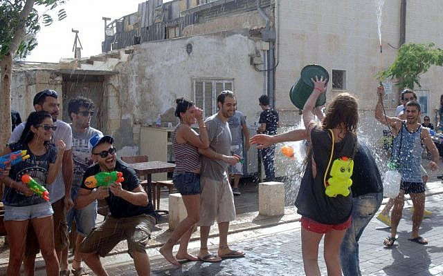 A water fight in Beersheba on Shavuot (photo credit: Dudu Greenspan/Flash90)