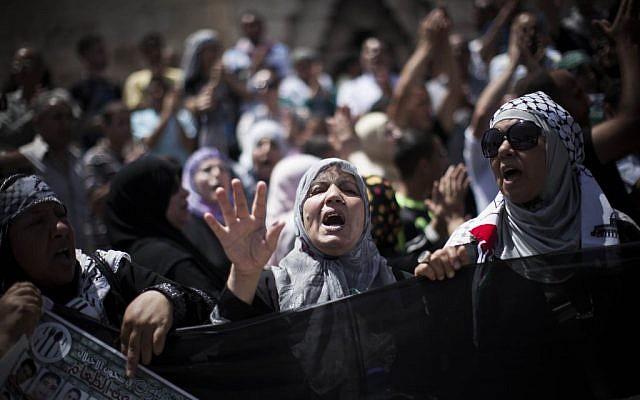 Palestinian demonstrators wave flags during a rally to mark Naksa Day on June 7, 2013 at Damascus Gate in Jerusalem.  (photo credit: Yonatan Sindel/Flash90)