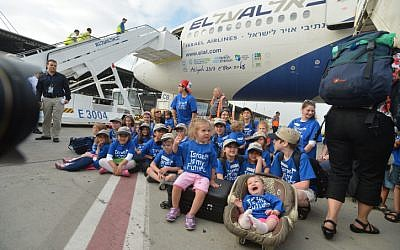 ILLUSTRATIVE: Jewish Orthodox North American nationals and new immigrants to Israel arrive in a special flight on behalf of the Jewish Agency and the Nefesh B'Nefesh organization, at Ben Gurion airport in central Israel, on July 23, 2013.  (photo credit: Yossi Zeliger/ Flash90)