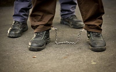 Illustrative photo of a prisoner in leg cuffs (Moshe Shai/Flash90)