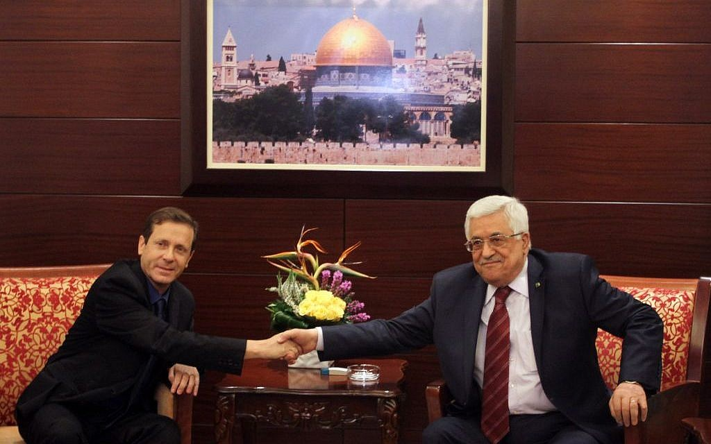 Opposition leader Isaac Herzog meets with Palestinian Authority President Mahmoud Abbas in the West Bank city of Ramallah. December 1, 2013. (Issam Rimawi/Flash90/File)