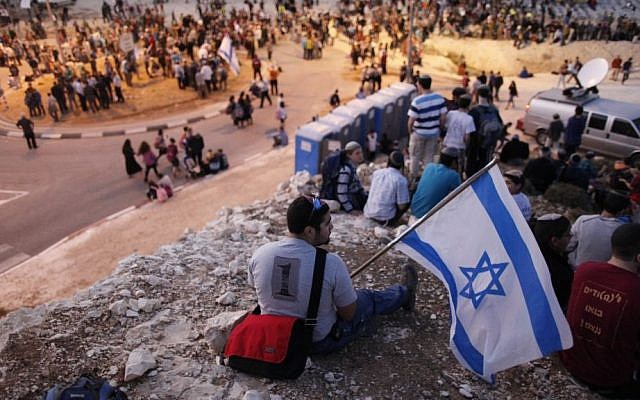 Israeli settlers hold a protest in the West Bank. File photo (Photo credit: Yonatan Sindel/Flash 90)