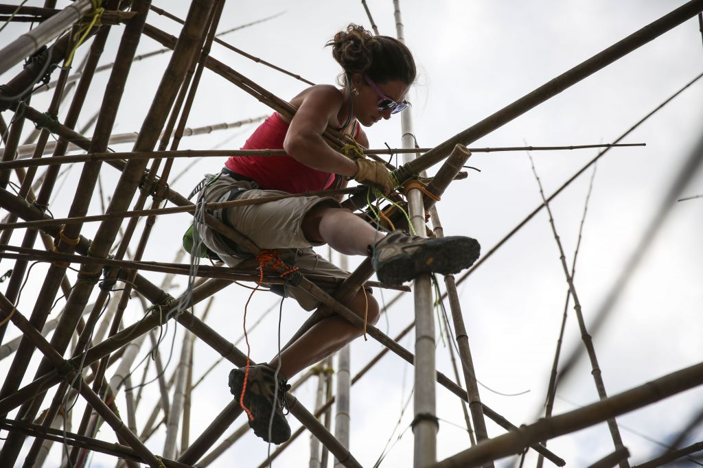 The Starn brothers brought in experienced rock climbers to help build the bamboo structure (photo credit: Hadas Parush/Flash 90)