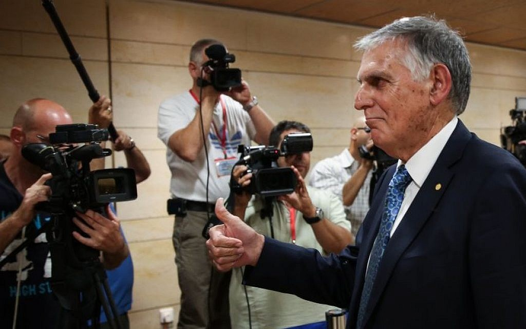 Prof. Dan Shechtman poses after handing in his candidacy for president, in the Knesset, May 27, 2014. (Photo credit: Hadas Parush/Flash90)
