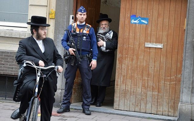 File. Extra police deploy in Belgium after a May 2014 attack at the Jewish museum in Brussels (Joods Actueel/FLASH90)