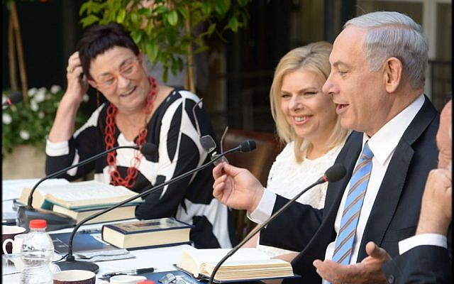 Israeli Prime Minister Benjamin Netanyahu and his wife Sara, center, at a Bible study session held at his official Jerusalem residence on June 1, 2014. (photo credit: Amos Ben Gershom/GPO/Flash90)