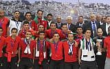 The Palestinian national soccer team along with PA President Mahmoud Abbas after winning the AFC Challenge Cup in late May 2014 (photo credit: Issam Rimawi/ Flash 90)