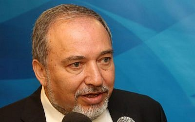 Foreign Minister Avigdor Liberman speaks with the press before entering the weekly cabinet meeting on Sunday, June 1, 2014. (photo credit: Marc Israel Sellem/POOL/Flash 90)