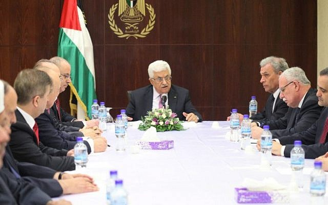 Palestinian Authority President Mahmoud Abbas meets with his new unity government in the West Bank city of Ramallah, June 2, 2014 (photo credit:  Issam Rimawi/Flash90)