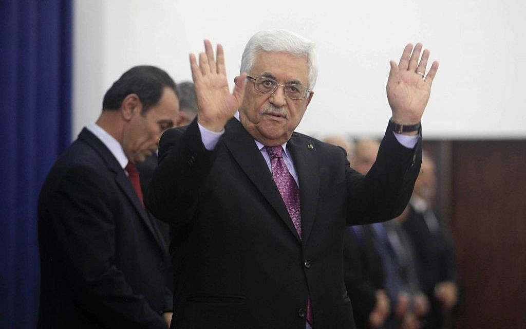 Palestinian President Mahmoud Abbas waves during the swearing-in ceremony of the new unity government in the West Bank city of Ramallah June 2, 2014. (photo credit: Issam RImawi/Flash90)