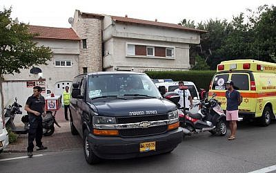 Police and rescue forces are seen outside the house where a two 12-year-old girls drowned to death in a private swimming pool at a home in Savyon on June 3, 2014. (photo credit: Gideon Markowicz/Flash90)