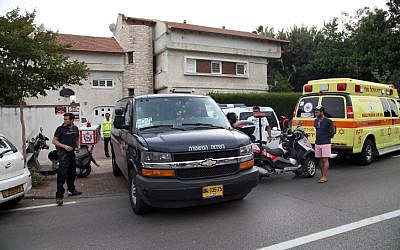 Police and rescue forces seen outside a house where  two 11-year-old girls drowned  in a private swimming pool at a home in Savyon on June 3, 2014 (photo credit: Gideon Markowicz/Flash90)