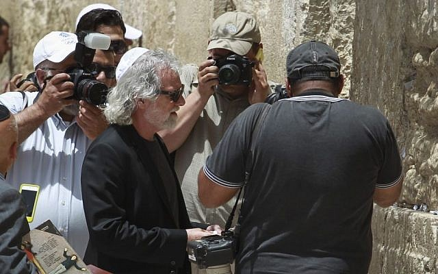 Chuck Leavell, keyboard player touring with the Rolling Stones, is photographed while placing a note in the Western Wall in Jerusalem's Old City on Tuesday, June 3, 2014, a day before the band's concert in Tel Aviv. Photo by Hadas Parush/Flash 90