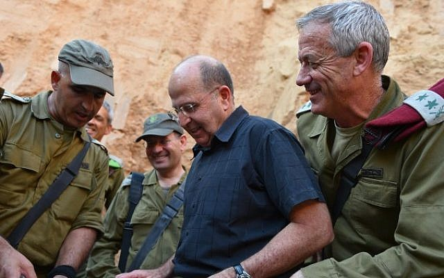Defense Ministry Moshe Ya'alon (center) and IDF Chief of Staff Benny Gantz (right) visit the IDF's Gaza Division on June 10, 2014. (photo credit: Defense Ministry/FLASH90)