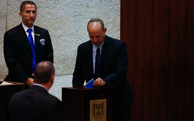 Economy Minister Naftali Bennett, leader of the Jewish Home party, casts his vote in the Knesset during presidential elections, Tuesday, June 10, 2014. (photo credit: by Yonatan Sindel/Flash90)