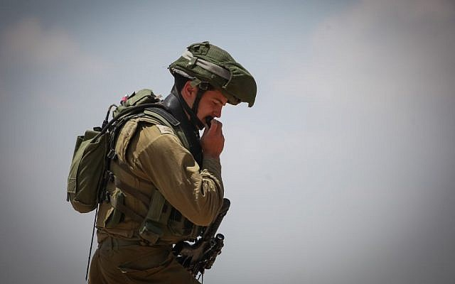 Israeli soldiers search the Palestinian territories around the Israeli settlement bloc of Gush Etzion, in the West Bank. on Friday, June 13. Three Jewish teenagers hitchhiking in the West Bank have been missing since Thursday night and are feared to have been kidnapped by terrorists, Israeli security officials said. (Photo by FLASH90)