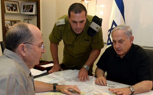 Prime Minister Benjamin Netanyahu and Defense Minister Moshe (Bogie) Ya'alon meet on June 13, 2014, as security forces search for three missing yeshiva students, feared kidnapped in the West Bank.  (photo credit: Haim Zach/GPO/Flash90)