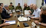 Prime Minister Benjamin Netanyahu meets with then-IDF Chief of Staff Benny Gantz, Defense Minister Moshe Ya'alon, Shin Bet head Yoram Cohen, Mossad director Tamir Pardo, and NSC head Yossi Cohen at the Defense Ministry in Tel Aviv, to discuss the disappearance of three Jewish teenagers near Hebron, in the West Bank, June 14, 2014. (Kobi Gideon/GPO/Flash90)