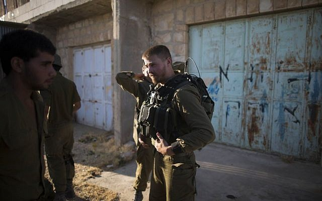 IDF soldiers prepare to search for three kidnapped Jewish teenagers near Hebron, in the West Bank, Saturday, June 14, 2014 (photo credit: Yonatan Sindel/Flash90)