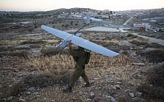 An Israeli soldier holds a Skylark drone during the search for three Jewish teenagers near Hebron, in the West Bank, June 14, 2014. (Yonatan Sindel/Flash90)