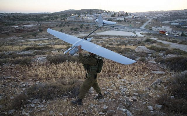 An Israeli soldier holds a Skylark drone during the search for three Jewish teenagers near Hebron, in the West Bank, June 14, 2014. (photo credit: Yonatan Sindel/Flash90)