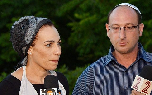 Ofir (right) and Bat-Galim Shaer, parents of murdered Israeli teen, Gil-ad Shaer, speak with the press outside their home in Talmon, on June 15, 2014. (Photo credit: Yossi Zeliger/Flash90)